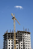 House under construction. With construction crane Stock Images
