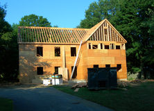 House under construction. New home being built under construction wood material and drywall in yard Royalty Free Stock Photography