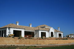 House under construction. A golf course home in spain under construction stock image