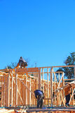 House Under Construction. Construction workers building new home Royalty Free Stock Image