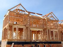 House Under Construction. House is being built under construction in wooden frame skeleton Stock Images