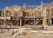House under construction. A new house being built, wooden framework, wooden boards and planks scattered all around Royalty Free Stock Photography