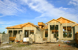 House under construction. House sold and under construction, showing concrete blocks, raw lumber and other building materials stock photos