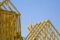 House Under Construction. Against blue sky stock photo
