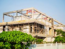 House under construction with autoclaved aerated concrete block structure at building site. In summer stock photos