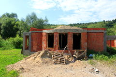House under construction. Bricks and wood Stock Images