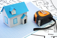 House under construction concept. Model house and   tape measure on construction plan. House under construction concept Royalty Free Stock Image