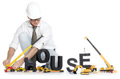 Build up a house: Engineer building house-word. Stock Photo