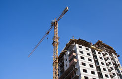 House under construction with construction crane Stock Image
