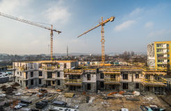 House under construction with cranes Royalty Free Stock Photo