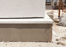 House under construction. Detail of finished plastered  foundation. Royalty Free Stock Photography