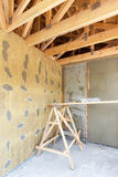 House under construction. Facade layers over  insulation, mesh,plaster, cement, mortar. Royalty Free Stock Photography