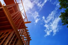 House under construction, framing is getting going. New Home Under Construction. New Home house under construction, framing is going royalty free stock photography