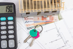 House under construction, keys, calculator and currencies euro on electrical drawings, concept of building home Royalty Free Stock Photography
