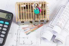 House under construction, keys, calculator, currencies euro and electrical drawings, concept of building home Stock Image