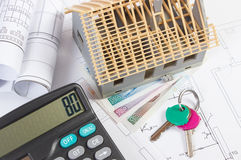House under construction, keys, calculator, polish currency and electrical drawings, concept of building home Royalty Free Stock Images