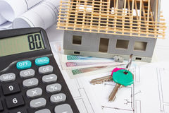 House under construction, keys, calculator, polish currency and electrical drawings, concept of building home Stock Photography