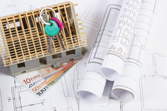 House under construction, keys, currencies euro and electrical drawings, concept of building home Royalty Free Stock Images