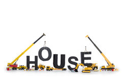 House under construction: Machines building house- Stock Images