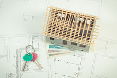 House under construction, polish currency money and keys on electrical drawings and diagrams for project, building home cost conce Royalty Free Stock Photos
