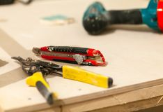 House is under construction, remodeling, rebuilding and renovation. Hand  tools are on the table. Royalty Free Stock Image