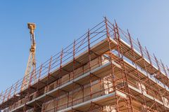 House under construction with scaffolding. Royalty Free Stock Image