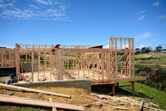 House under construction. A timber frame house under construction Stock Images