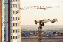 House under construction with a tower crane Royalty Free Stock Images