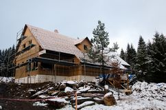 House under construction in winter royalty free stock photos