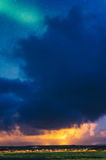House under heavy clouds and northern lights Royalty Free Stock Photography