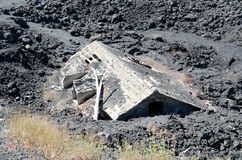 House under lava Stock Photo