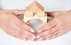 House under the protection. Of women Royalty Free Stock Image
