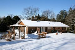 House under the snow. Red brick house covered with snow back yard view Stock Photography
