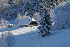 House under snow. Landscape of mountain showing a house under snow Stock Photos
