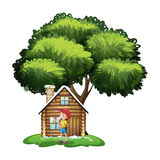 A house under the tree with a little girl playing Royalty Free Stock Image