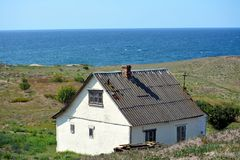 House in the valley by the sea stock photography
