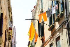 Venice Domestic Life. A house in Venice, Italy with the laundry hanging outside to dry Royalty Free Stock Photos