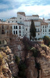 House in vertical in altitude. White houses located next to each other in the town of Ronda in Malaga, Spain, are houses perched on a steep mountain at high Royalty Free Stock Image