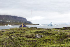 House with view to iceberg Stock Photo