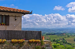 House with a view on Tuscany landscape near San Gimignano Royalty Free Stock Photo