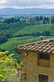 House with a view of Tuscany landscape near San Gimignano Stock Photo