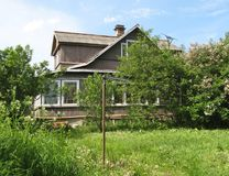 House in the village. Summer house in the Russian village, with slashes in the yard Stock Image