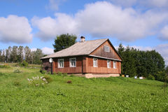 House in a village. Wooden house in a village royalty free stock photos