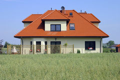 House on village. In Poland. Green cereal Royalty Free Stock Images
