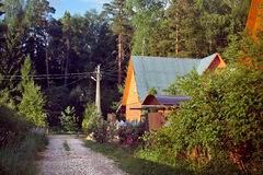 A house in a village by a forest Stock Photography