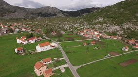 The house and the village in the mountains. The village Njegusi. In Montenegro, on the mountain Lovcen. Aerial Photo drone