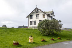 House in a village in northern Norway. Surrounded by a garden on a cloudy day Stock Photography