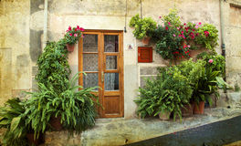 House in village Valldemossa in Mallorca, Spain. Vintage photo of traditional house in mediterranean village Valldemossa Mallorca, Spain Stock Photos