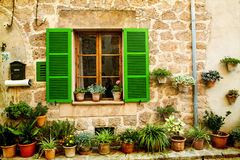 House in village Valldemossa in Mallorca, Spain. Vintage photo of traditional house in mediterranean village Valldemossa Mallorca, Spain Stock Images