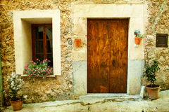 House in village Valldemossa in Mallorca, Spain. Vintage photo of traditional house in mediterranean village Valldemossa Mallorca, Spain Royalty Free Stock Image